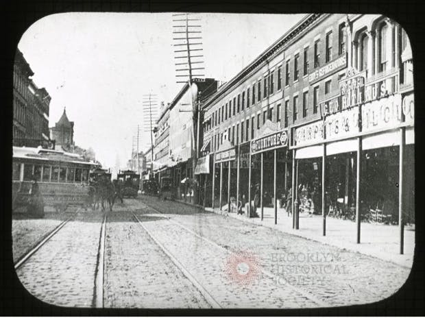 a black and white photo of a city street