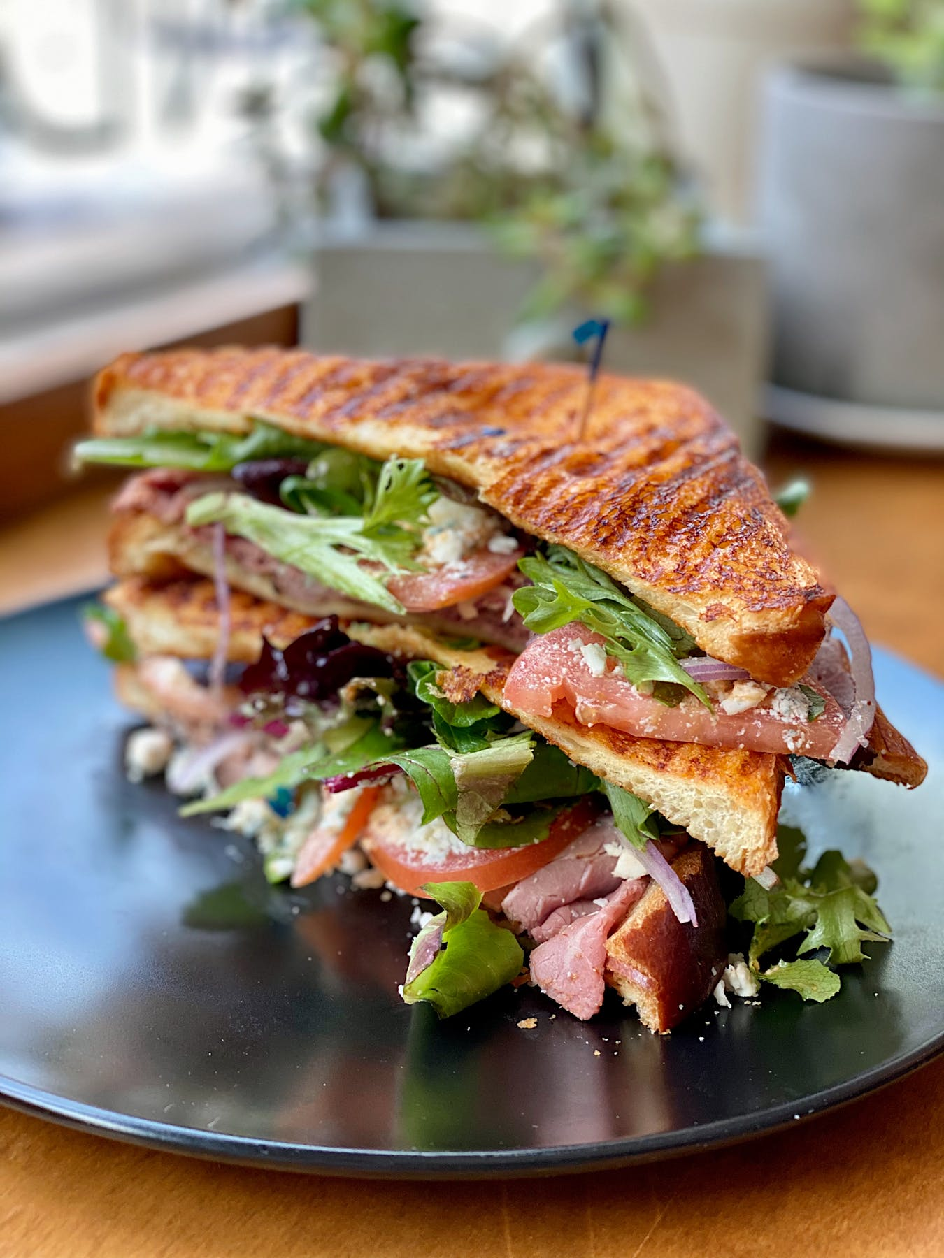 a close up of a sandwich and salad on a plate