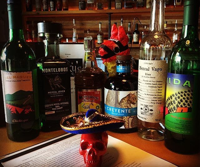 A red skull, and an array of different liquors