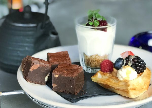 a plate of food with a slice of cake on a table