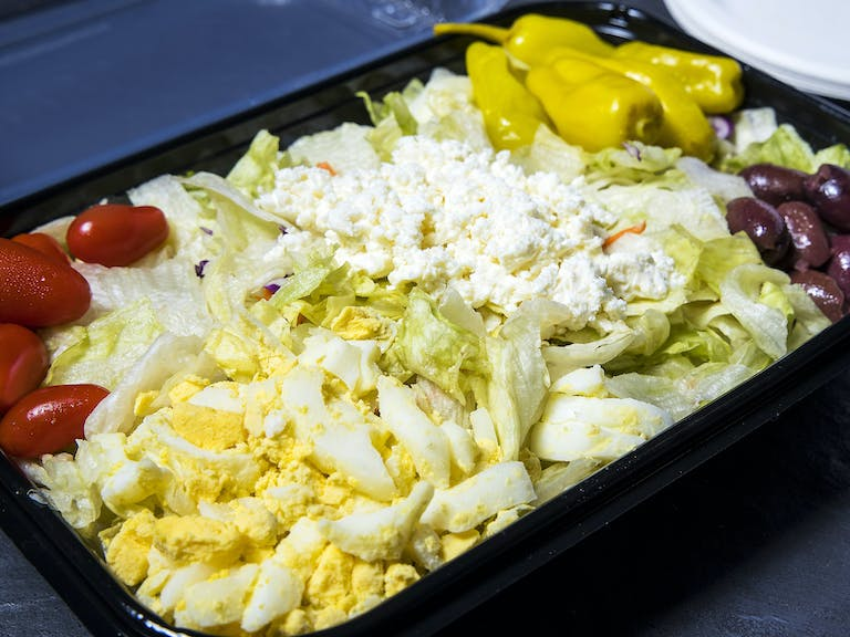 a tray of food with rice and vegetables