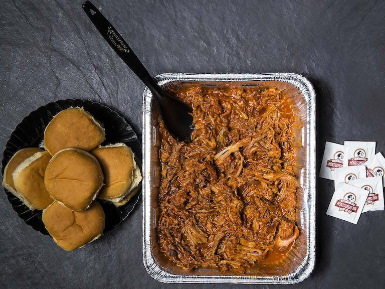 a tray of food with a fork and knife