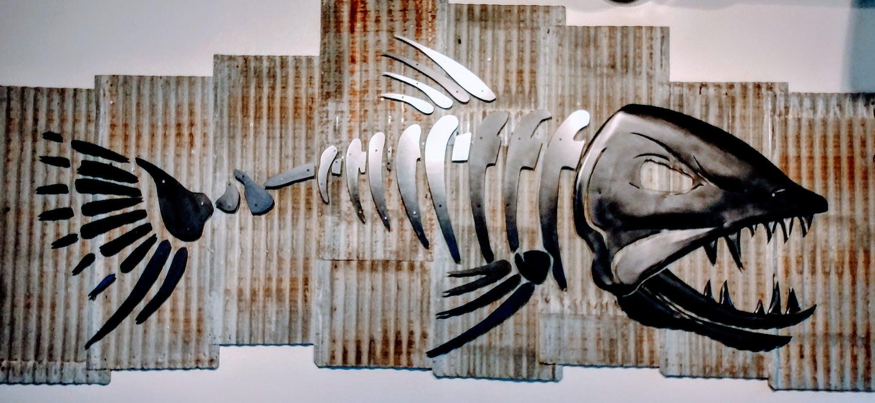 metal fish in wall