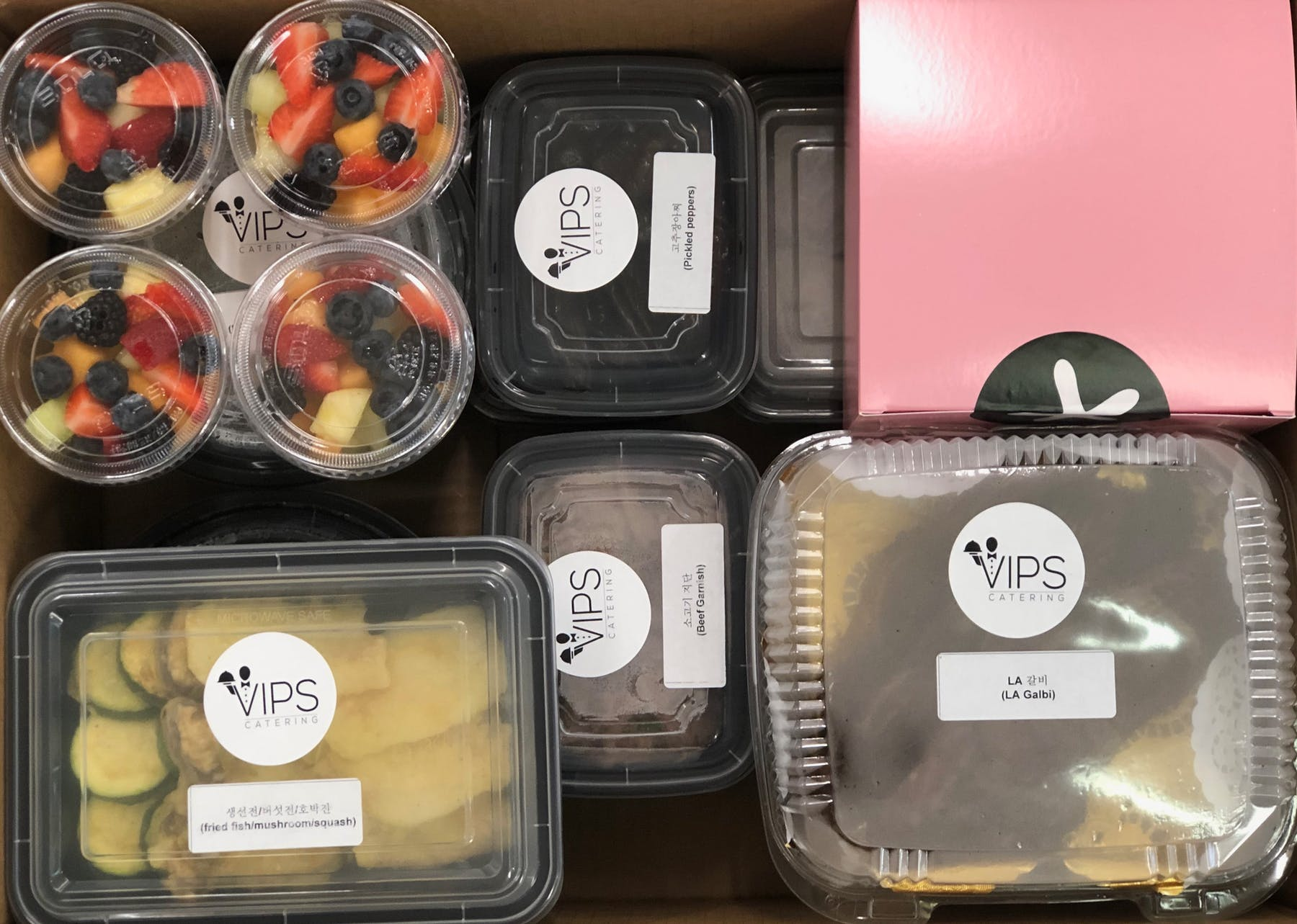 a group of plastic containers filled with food