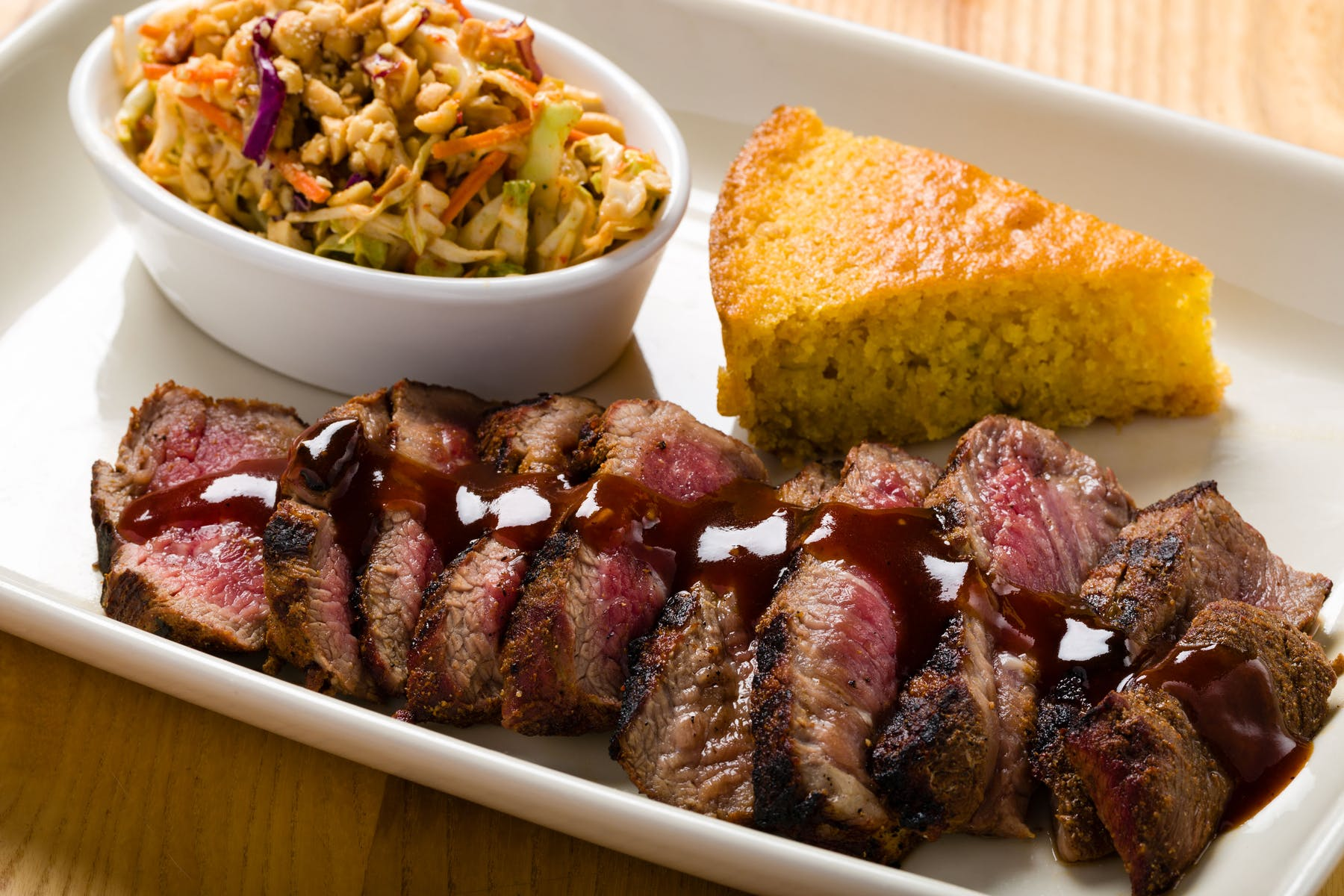 steak slices with corn bread and coleslaw