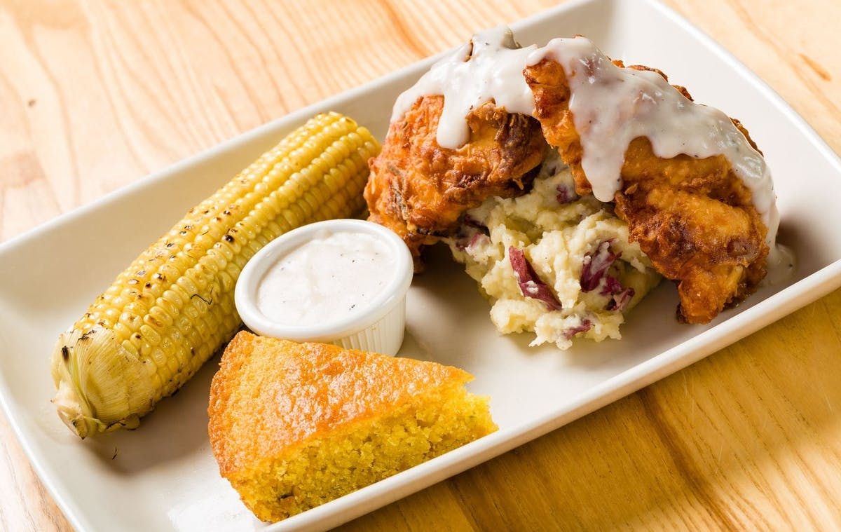 corn, corn bread and fried chicken with mashed potatoes