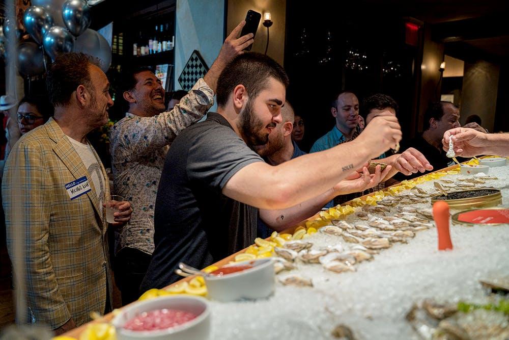 a man cutting a cake