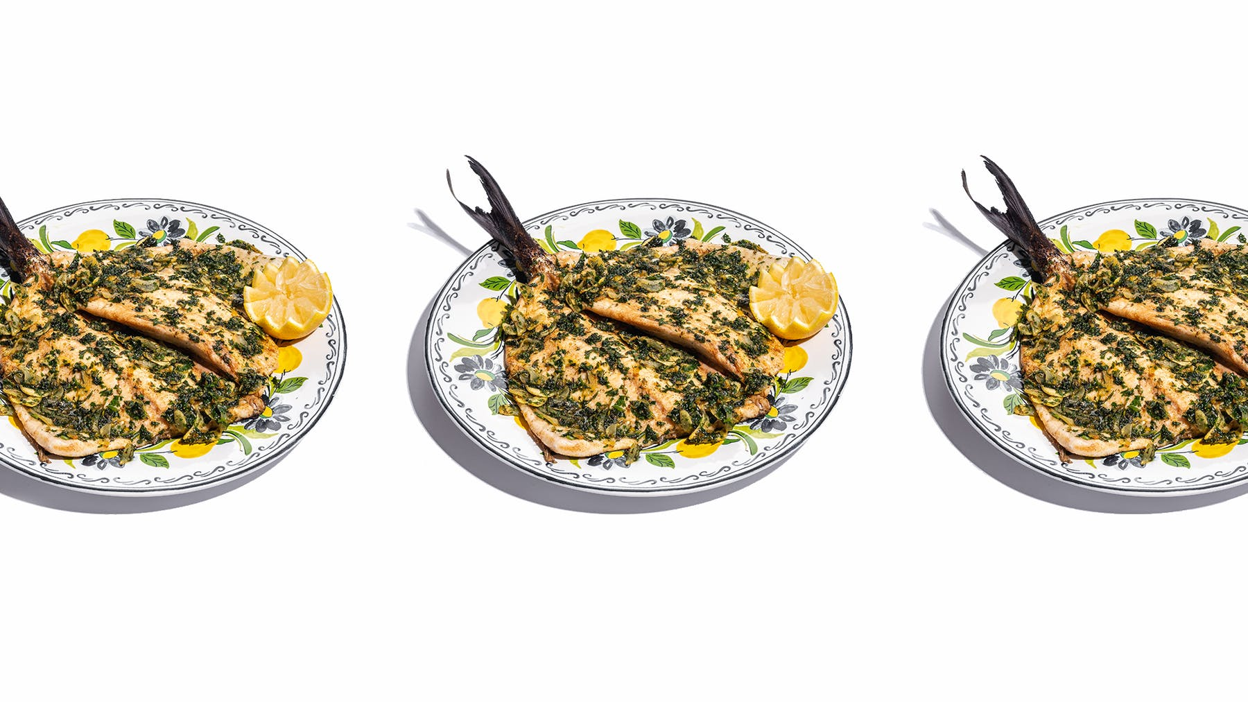 multiple plates of food sitting on a white surface