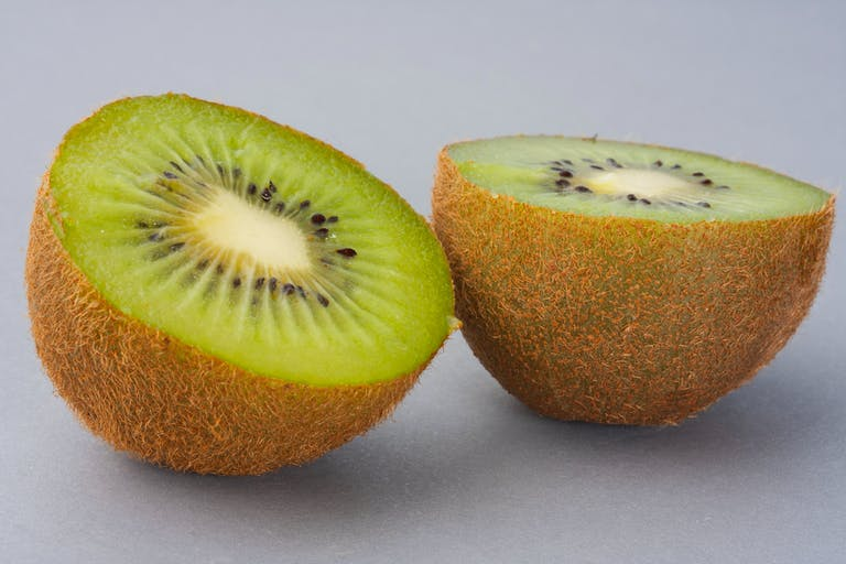 a group of kiwi fruit