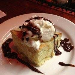 a piece of cake and ice cream on a plate