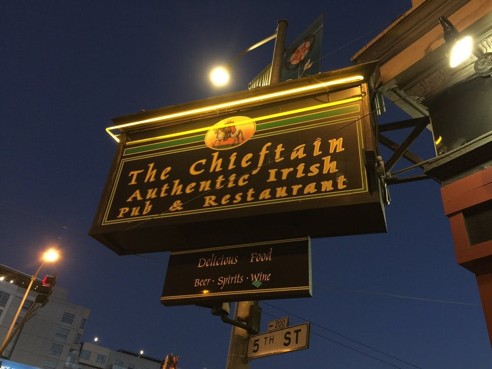 a sign lit up at night