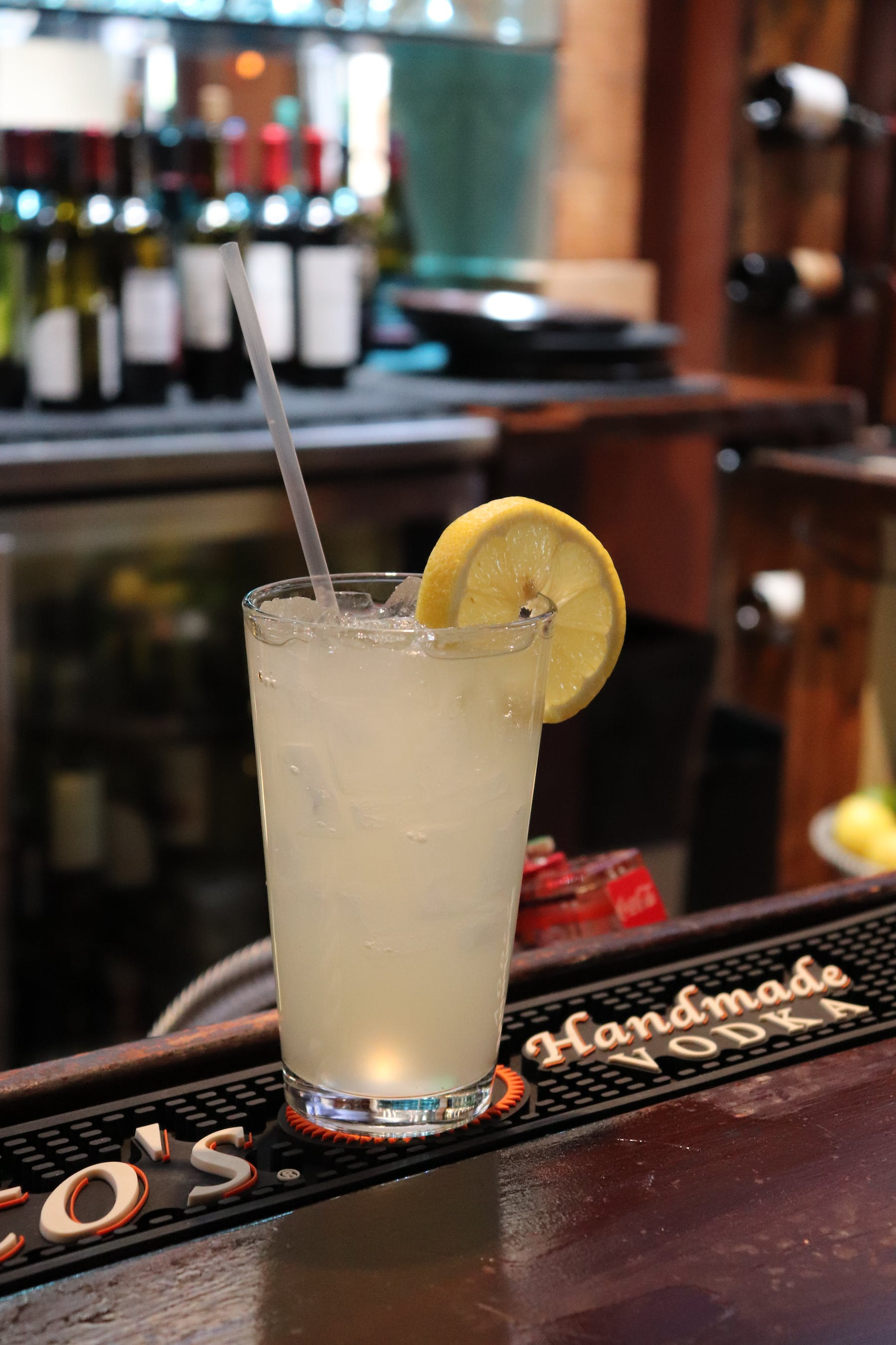 a close up of a drink with a lemon slice as decoration