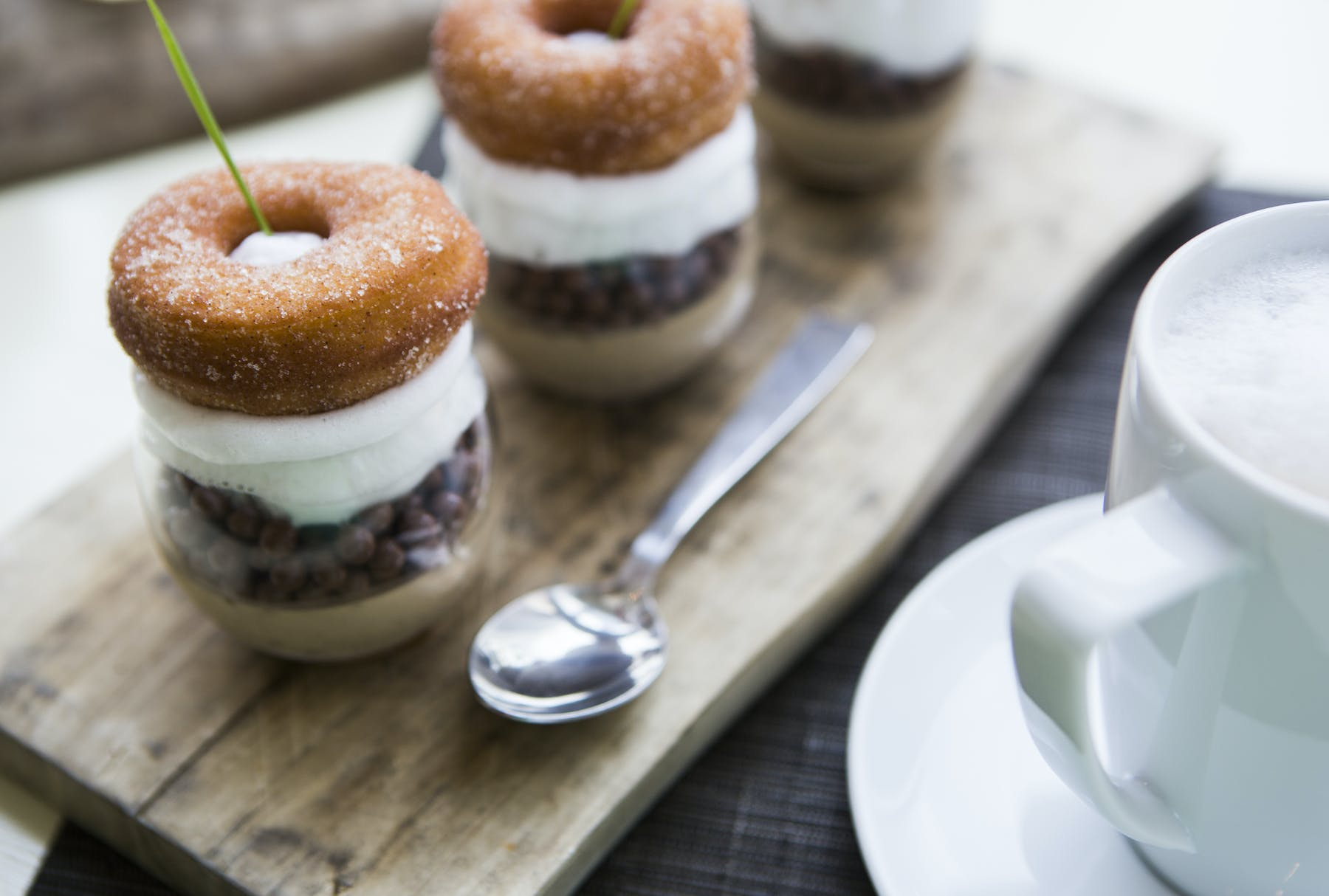 donut dessert glasses in  a table