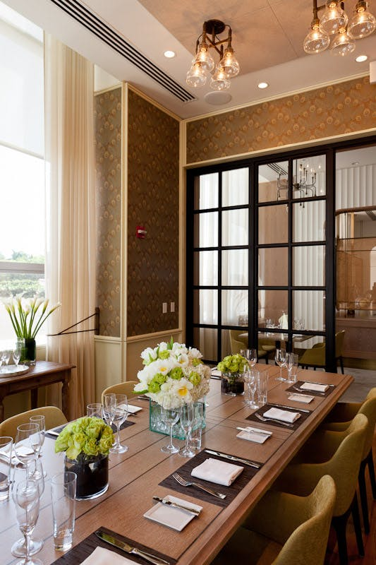 a private dining room table in front of a window