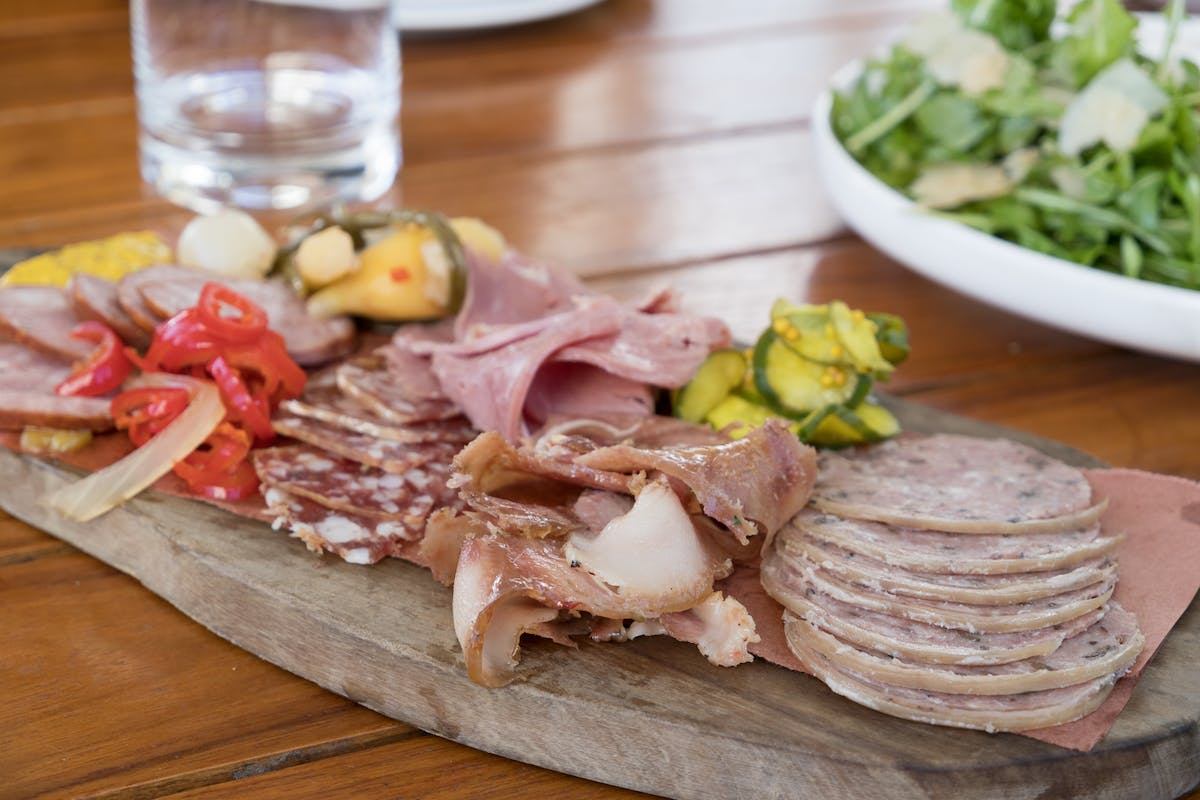 a charcuterie board on a wooden cutting board