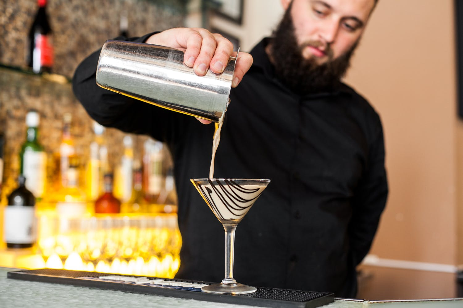 bartender pouring chocolat cocktail