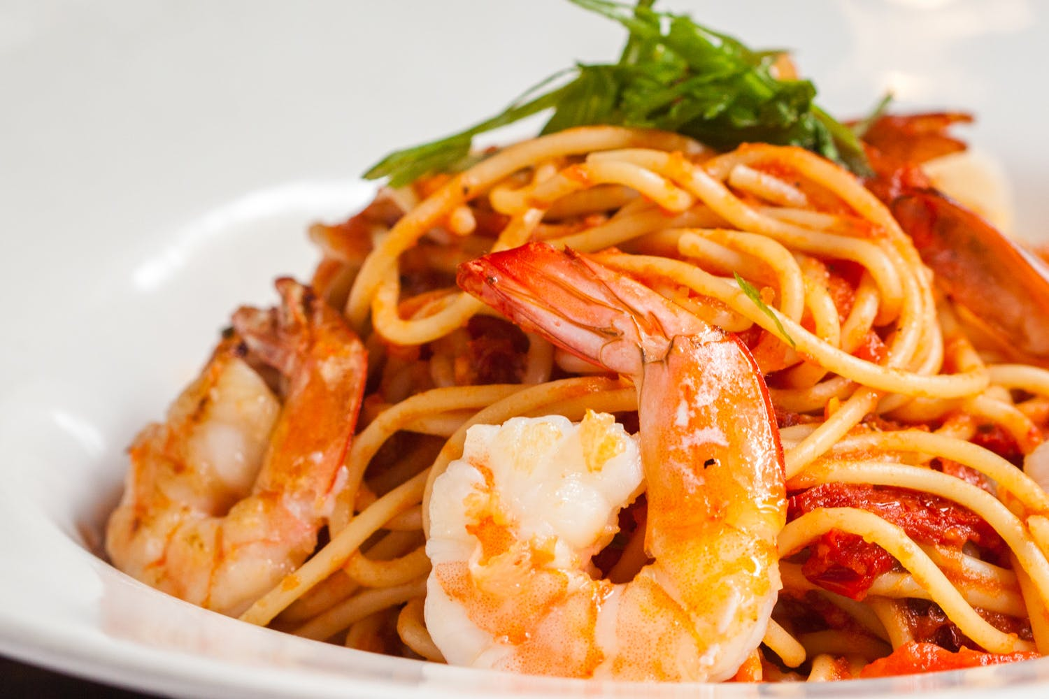 a plate of spaghetti and shrimp