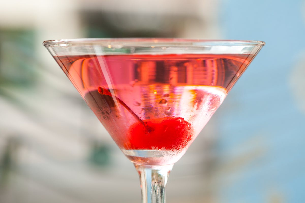fruity summer cocktail with a cherry