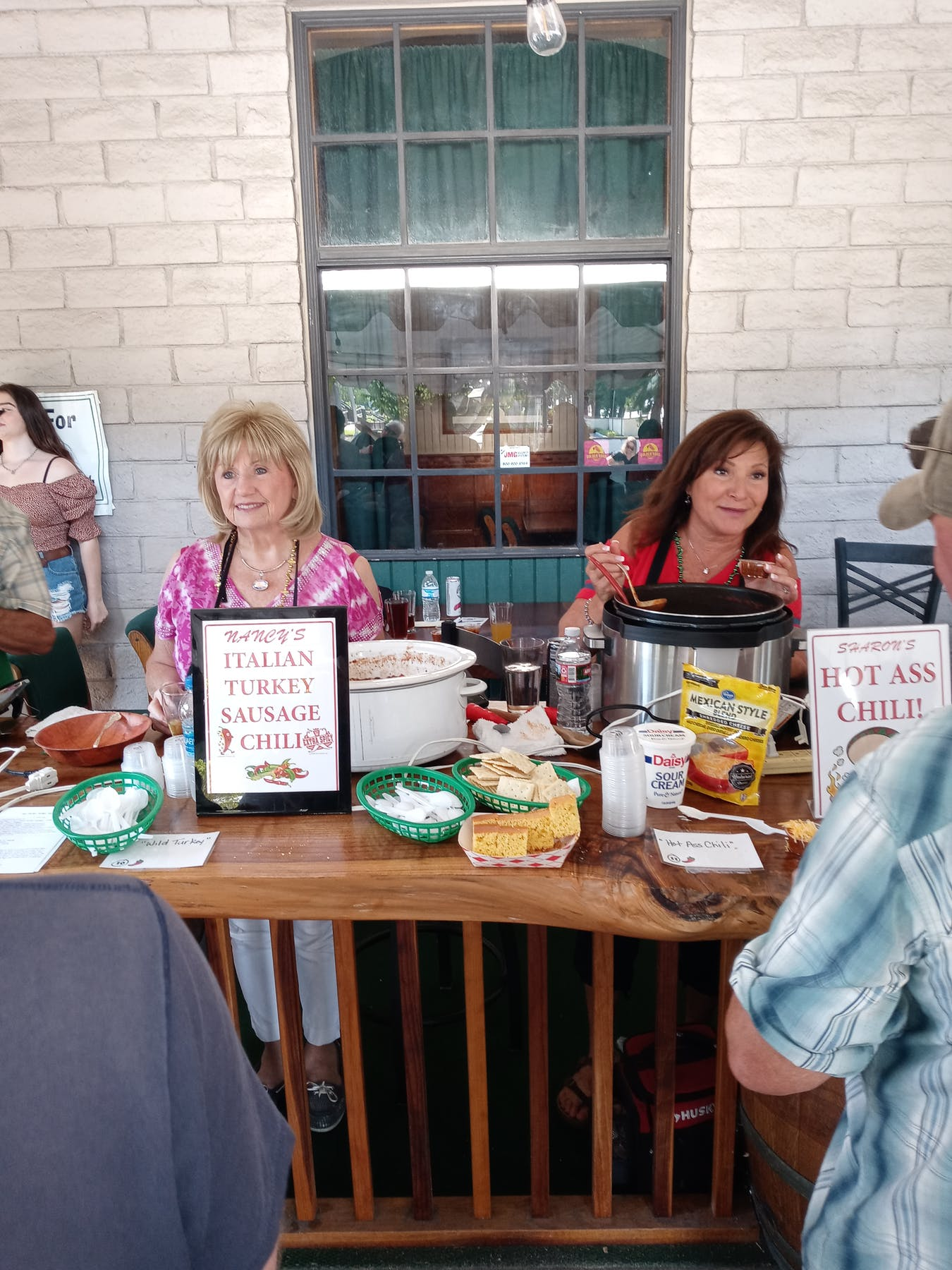 Judy Finnigan et al. sitting at a table in a restaurant