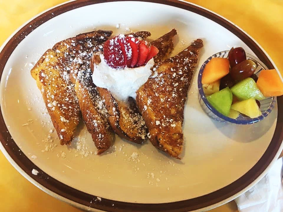 french toast with fruits at the side