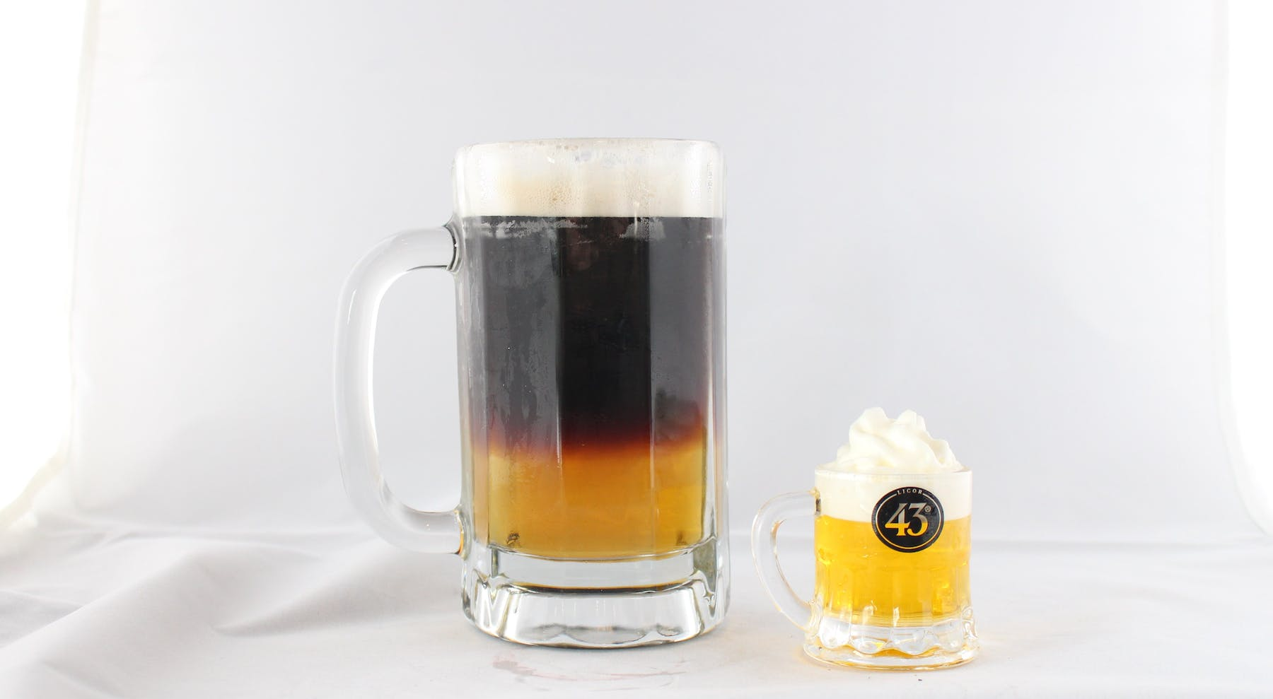 two glass mugs on a table