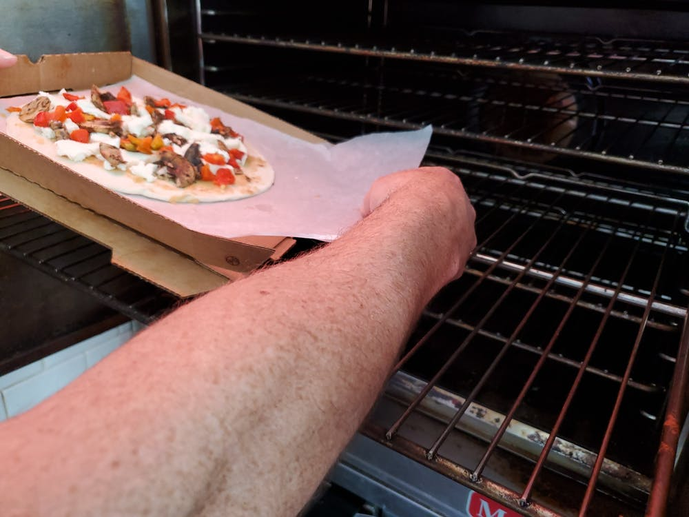 a man cooking pizza