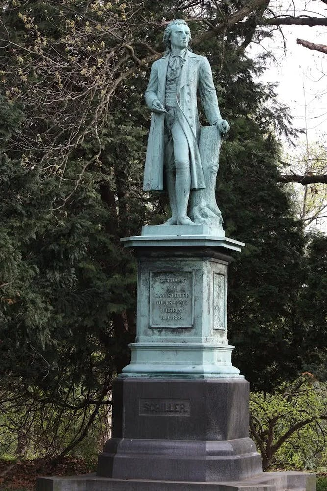 a person standing in front of a statue