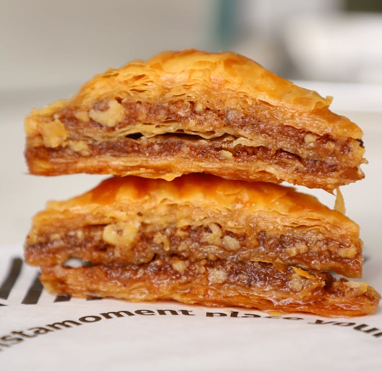 Baklava Layers of phyllo dough filled with chopped nuts & honey