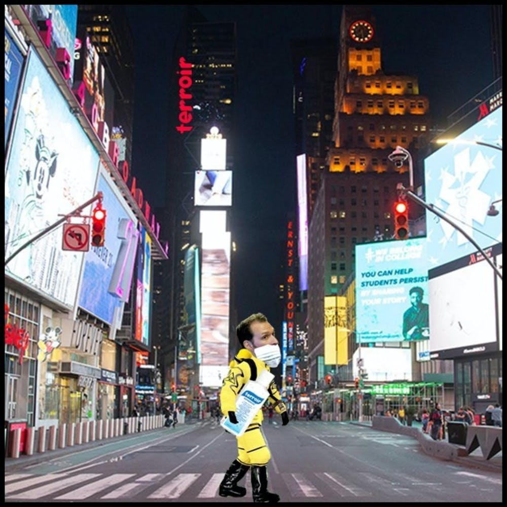 a person walking down Times Square street