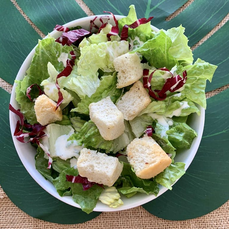 a close up of a green salad on a plate