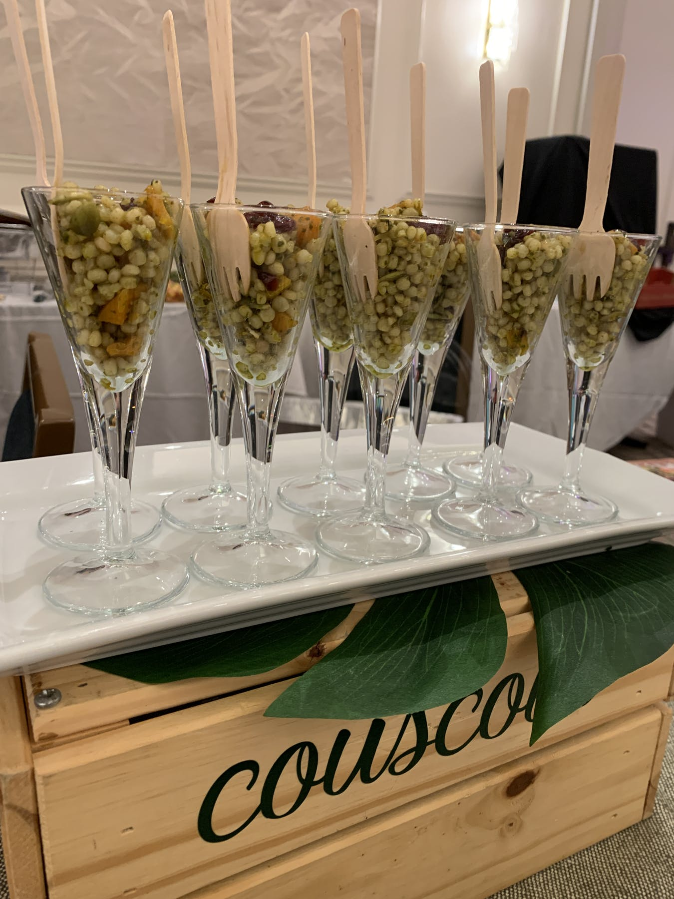 a row of wine glasses on a table