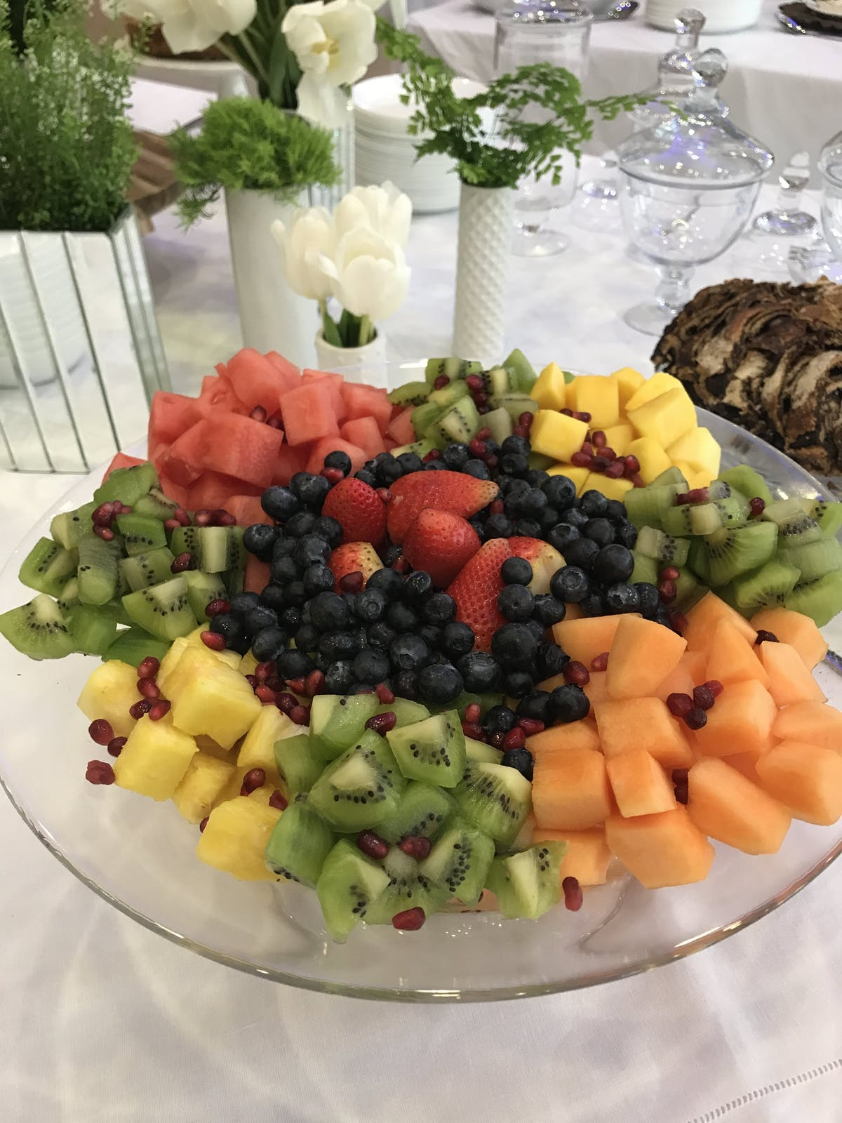 a table topped with different types of food on a plate