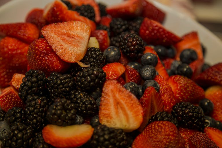 a white plate topped with different types of fruit