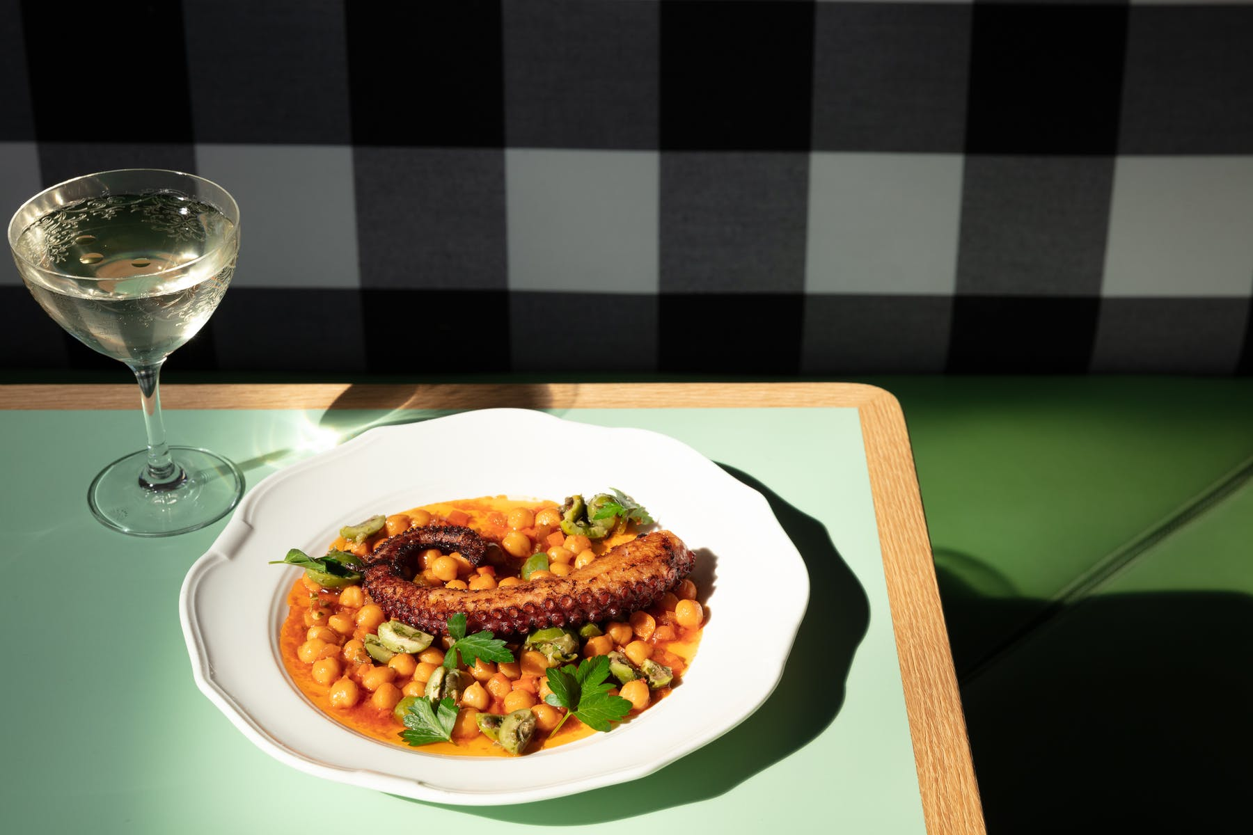 a plate of food and a glass of wine