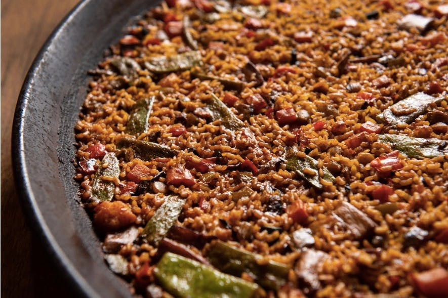 a close up of a paella