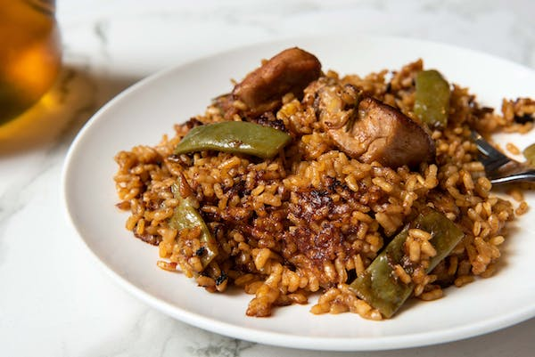 a plate of food with rice meat and vegetables