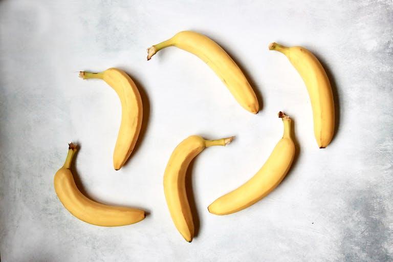 6 bananas on a table