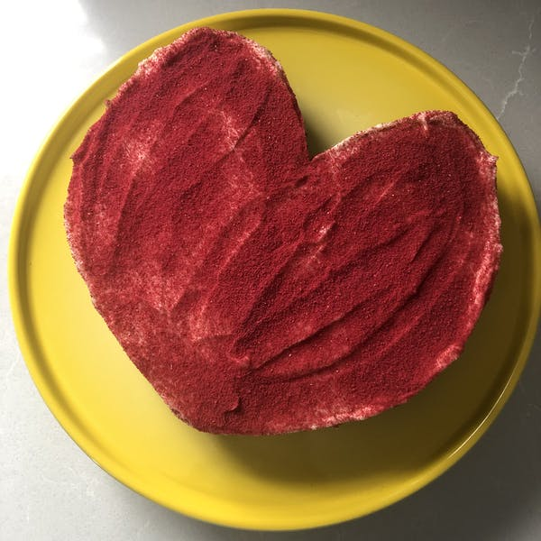 a close up of a heart shaped cake