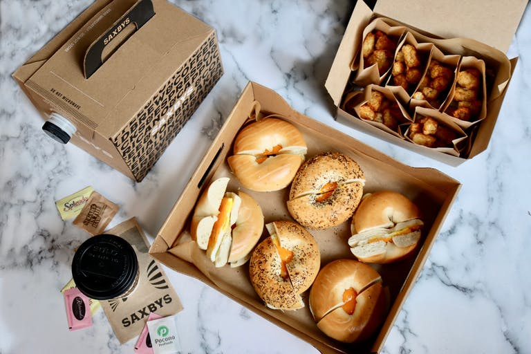 Saxbys The OG party pack with breakfast sandwiches, a brew box, and a air-fried tots box
