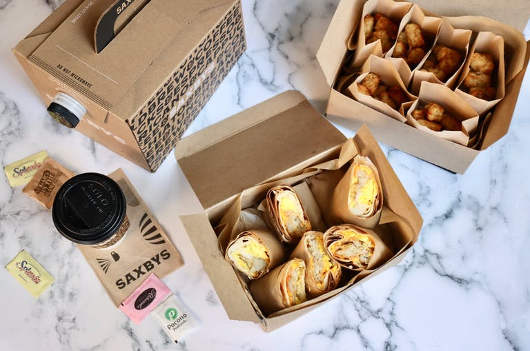 the Saxbys Burrito-ful party pack with a box of breakfast burritos, a box of air-fried tots, and a brew box