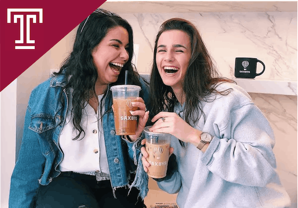two women holding cups of cold brew