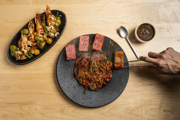 a plate of food sitting on top of a wooden table