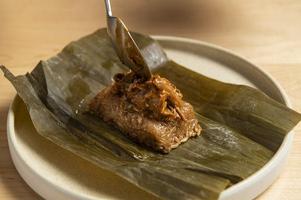 sticky rice tamal with duck confit