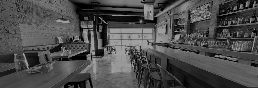 a black and white photo of a dining room table