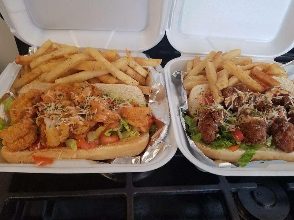 a couple of hot dogs with different toppings sitting on a tray
