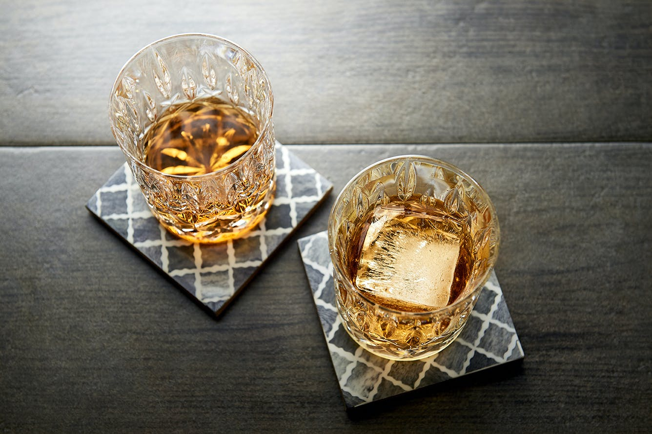 two drinks sitting on coasters