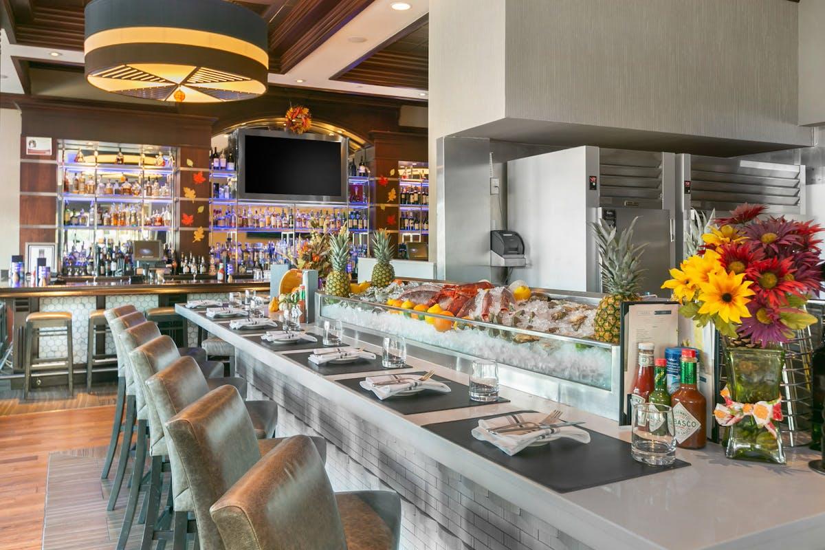 a restaurants bar with a big tv screen