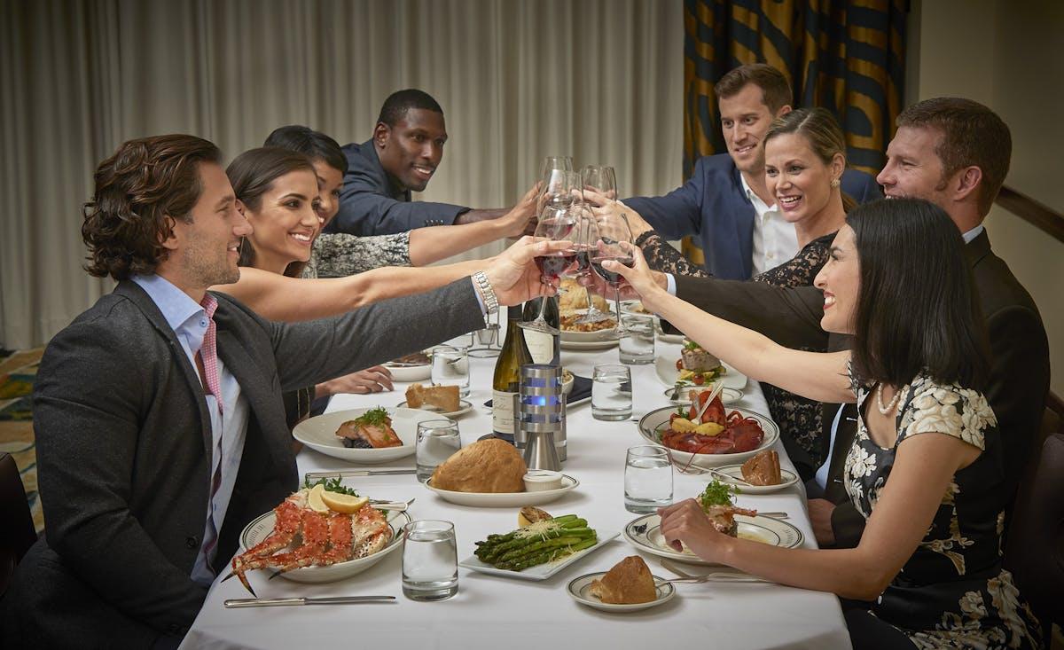 Cory Shivar et al. sitting at a table eating food
