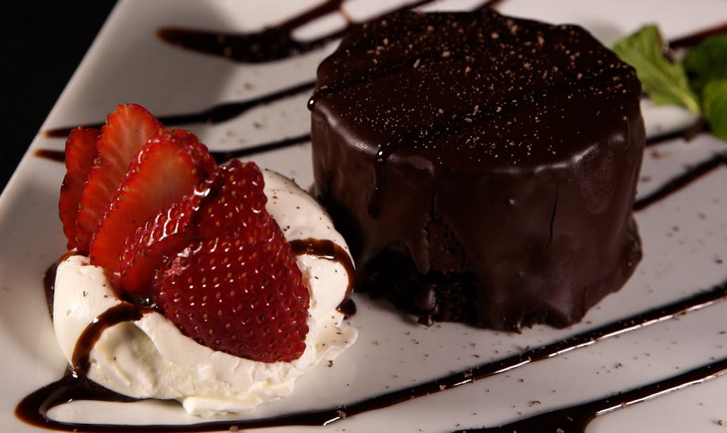 a piece of chocolate cake and ice cream on a plate
