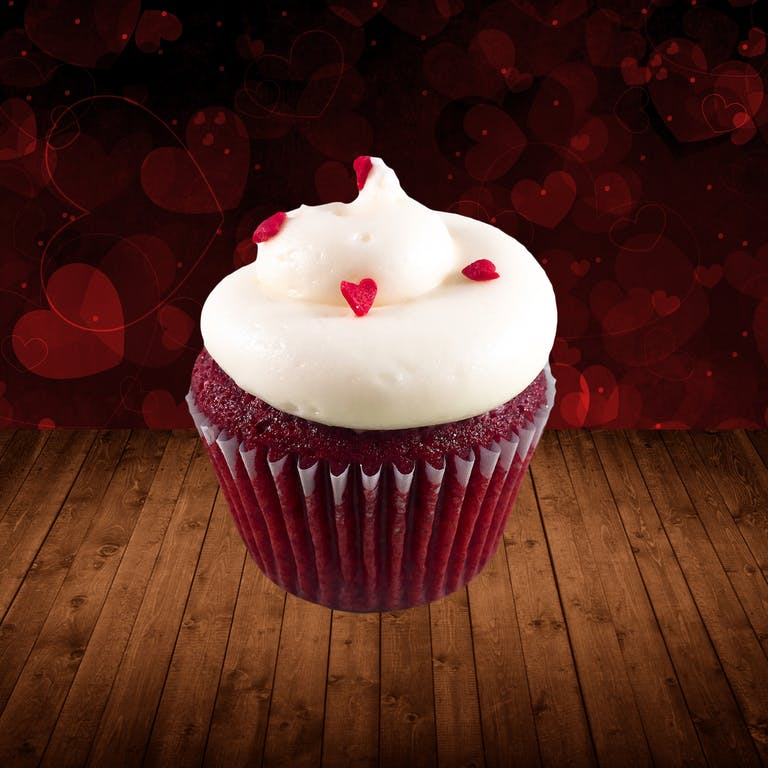 red velvet cupcake topped with cream cheese